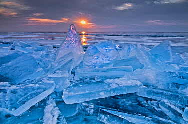 Shards of ice against the rising sun, north shore of Lake Superior, Minnesota  -  Rafael Rojas/ Biosphoto
