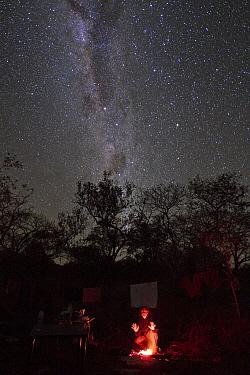 Campsite under Milky Way during dry season, Gorongosa National Park, Mozambique  -  Piotr Naskrecki