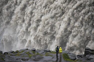 Tourists admiring Dettifoss Waterfall, Vatnajokull National Park, Iceland  -  Rob Brown/ Hedgehog House