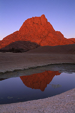 Granite reflection in rock pool, Spitzkop, Damaraland, Namibia  -  Michael & Patricia Fogden