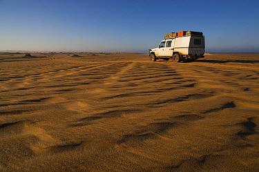 Car on sand dunes north of Moewe Bay, Namib Desert, Namibia  -  Theo Allofs