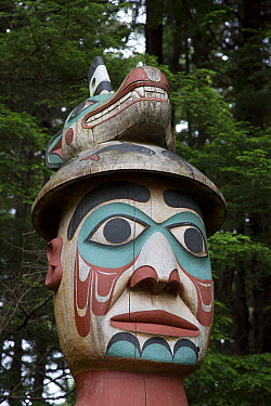 Man Wearing Bear Hat Totem carved by the Tlingit people acts as grave marker, Totem Bight State Historical Park, Ketchikan, Alaska  -  Matthias Breiter