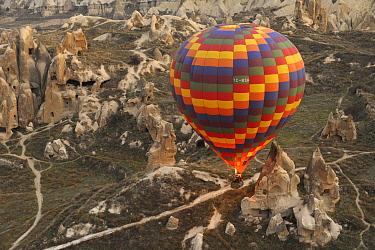 A hot air balloon over volcanic landscape, Cappadocia, Turkey  -  Natalia Paklina/ Buiten-beeld