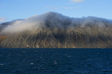 Clouds hugging the tops of shoreline mountains, Wrangel Island, Russia  -  Sergey Gorshkov