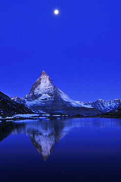 Matterhorn reflected in the Riffelsee Lake under a full moon, Switzerland  -  Thomas Marent