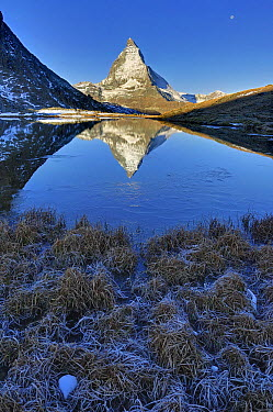 The Matterhorn reflected in the Riffelsee Lake at dusk, Switzerland  -  Thomas Marent