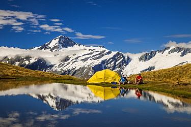 Hikers making hot drinks, Cascade Saddle, Mount Aspiring National Park, Otago, New Zealand  -  Colin Monteath/ Hedgehog House