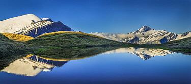 Mount Aspiring reflected in high mountain lake, Cascade Saddle, Mount Aspiring National Park, Otago, New Zealand  -  Colin Monteath/ Hedgehog House