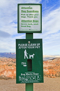 Sign for dogs owners to clean up after pets, Bryce Canyon National Park, Utah  -  Yva Momatiuk & John Eastcott