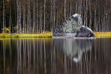 Rock and trees reflected in lake, Norway  -  Karin Broekhuijsen/ Buiten-beeld