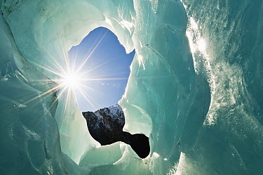 Ice cave and sunburst, Franz Josef Glacier, Westland National Park, New Zealand  -  Petr Hlavacek/ Hedgehog House