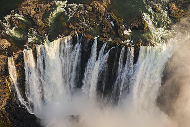 Victoria Falls cascading 420 feet into chasm, largest waterfall in the world, UNESCO World Heritage Site, Zimbabwe  -  Vincent Grafhorst