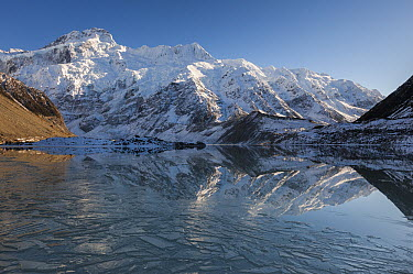 Mount Sefton reflection in ice covered Mueller Lake, Mount Cook National Park, Canterbury, New Zealand  -  Colin Monteath/ Hedgehog House