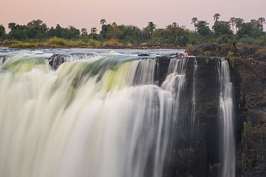 People swimming in pool at the top of falls, Victoria Falls, Zimbabwe  -  Vincent Grafhorst