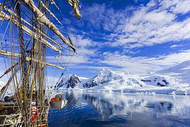 Sailship near coast, Antarctic Peninsula, Antarctica