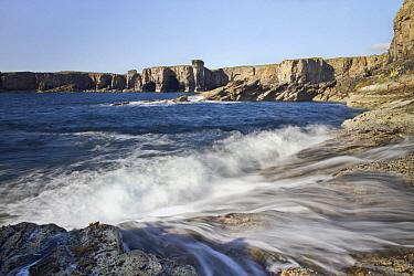 Waves crashing on rocky coastline, Orkney Islands, Scotland