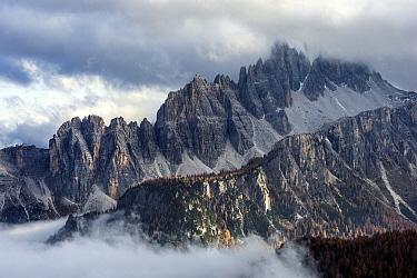 Mountain range in clouds, Croda da Lago, Dolomites, Italy