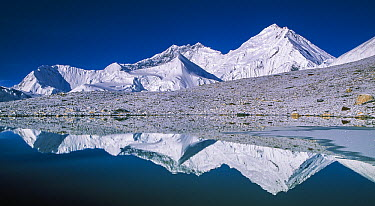 Kangshung Face, South Col and Lhotse reflected in small glacial pond, Mount Everest, Tibet  -  Colin Monteath, Hedgehog House