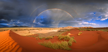 Storm with rainbows over sand dunes, NamibRand Nature Reserve,Namibia