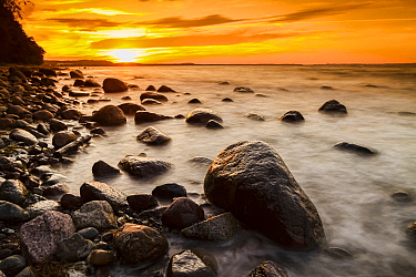 Coastal rocks at sunset on the island of Rugen, Baltic Sea, Germany