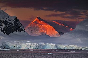 Alpenglow lighting up high peaks of Wiencke and Anvers Islands, near Port Lockroy, Antarctic Peninsula, Antarctica