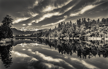 Clouds and mountains reflected in lake, Lake Matheson, Mount Tasman and Mount Cook, Westland National Park, New Zealand