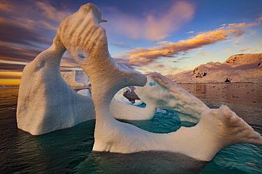 Iceberg with thin arch at sunset, Cierva Cove, Antarctic Peninsula, Antarctica