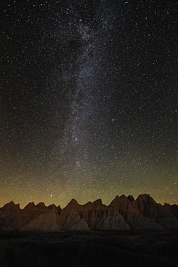 Milky way over sandstone rock formations, Badlands National Park, South Dakota
