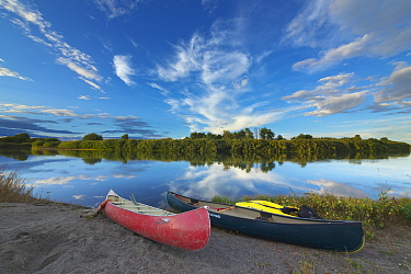 Evening clouds reflecting in river and canoes, Snake River, Idaho