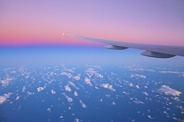 Calm ocean and white clouds seen from airplane, New Zealand,