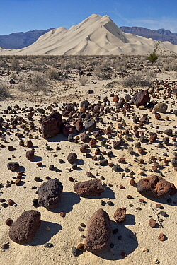 Sand dunes and scattered rocks, Death Valley National Park, California