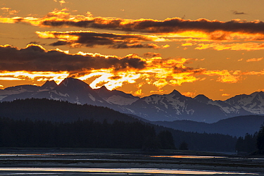 Sun setting behind mountains, Lynn Canal, Juneau, Alaska