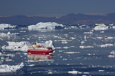 Ferry moving between icebergs, Ilulissat, Greenland