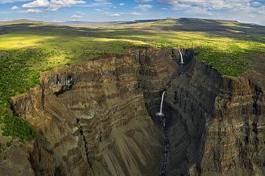 Waterfalls in deep canyon in plateau, Putoransky State Nature Reserve, Putorana Plateau, Siberia, Russia