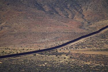 Border wall seperating Mexico and United States, Blue Angels Peak, Sierra de Juarez, Colorado Desert, Sonoran Desert, California