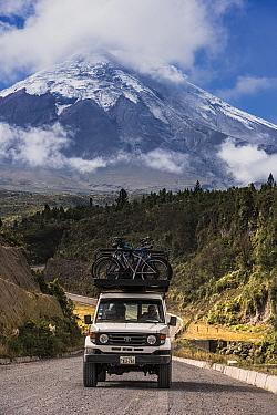Car carrying bikes near volcano, Cotopaxi Volcano, Cotopaxi National Park, Andes, Ecuador
