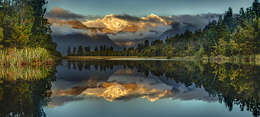 Mountains reflected in lake at sunset, Lake Matheson, Mount Tasman and Mount Cook, Westland National Park, South Island, New Zealand