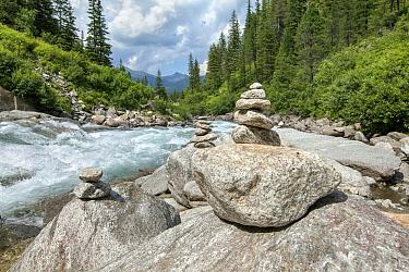 Stacked stones near river, Krimmler Achen Valley, Austria, July