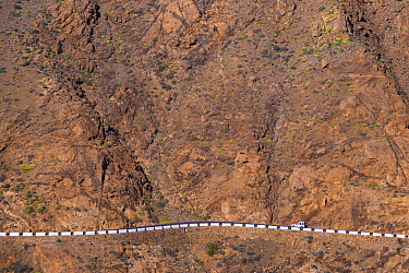 Car on steep mountain road, Parque Rural de Bentancuria, Fuerteventura, Canary Islands, Spain