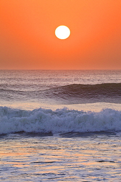 Sun setting over ocean, Cape Cross, Namibia