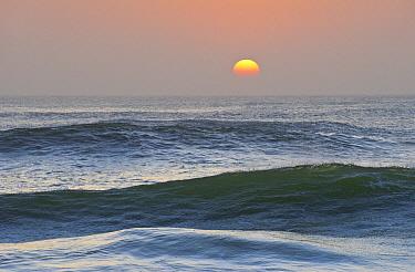 Sun setting over ocean, Cape Cross, Namibia