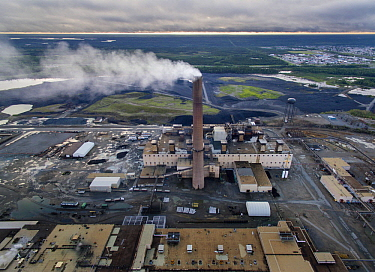 Aerial view of smoke billowing from stack at Vale Inco Manitoba nickel smelter and mine, Thompson, Manitoba, Canada