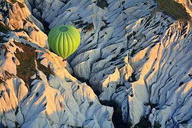 Hot air balloon over eroded limestone, Cappadocia, Turkey