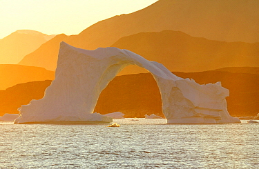 Arched iceberg at sunset, Straight of Vaigat, Greenland