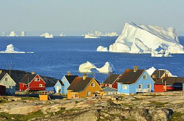Icebergs and Qeqertarsuaq village, Disko Island, Greenland