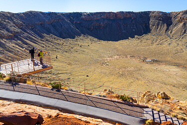 Tourists at Meteor Crater is a meteorite impact crater, Arizona