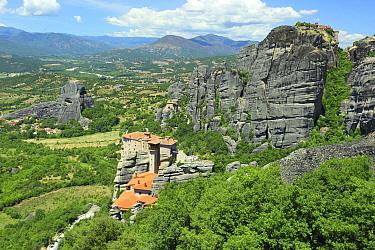 Village below monolithic pillars, Meteora, Kalambaka, Greece