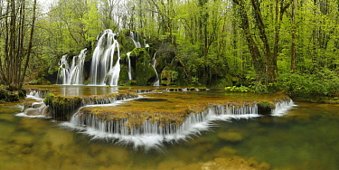Cascade Tufs waterfall and cascading creek in forest, Jura, France