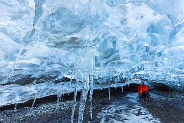 Explorer in ice cave, Vatnajokull Glacier, Iceland