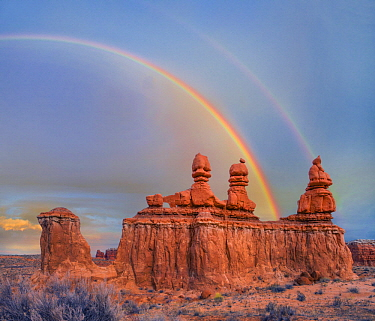 Rainbow over rock formation called the Three Judges, Goblin Valley State Park, Utah